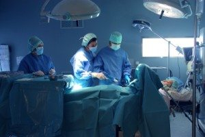 Doctors in surgery. BMES medical equipment lighting system